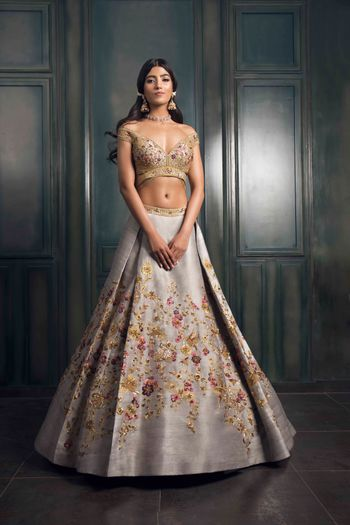 Photo of Light grey lehenga with multicolored embroidery and gold detailings