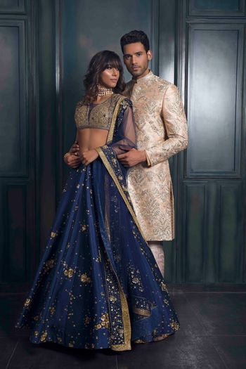 Photo of Stunning blue and gold cocktail lehenga
