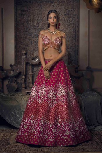 Photo of Bright pink and gold lehenga with off shoulder blouse