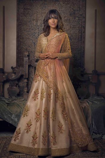 Photo of Elegant peach and gold lehenga