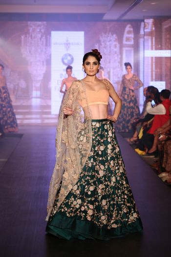 Photo of emerald green raw silk lehenga