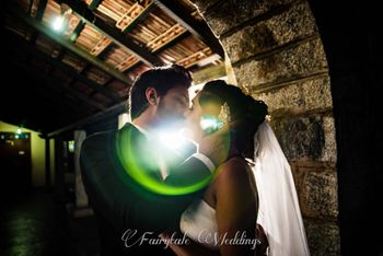 Photo of Couple kissing portrait with lens flare