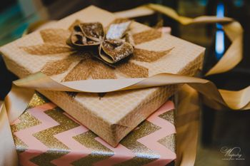 pink and gold wedding packaging