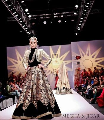 Photo of black and gold lehenga