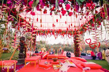 Floral mandap decor with red and pink theme