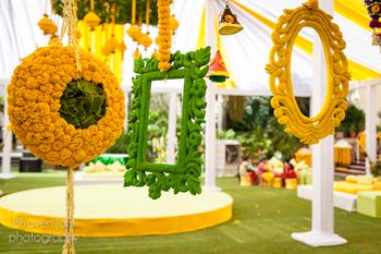 Hanging yellow and green frames as photobooth for mehendi