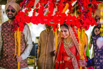 Beautiful bride under phoolon ki chadar shot