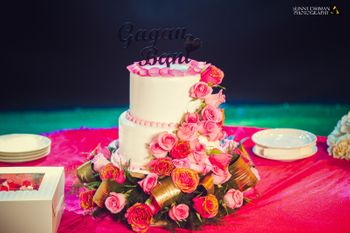 Photo of white two tiered cake with flowers on it