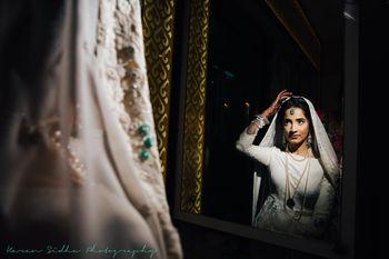 Pretty bridal portrait looking into mirror