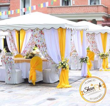 Photo of White yellow and floral pring canopy decor