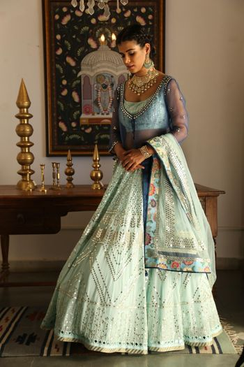 Gorgeous cape lehenga in tones of blue and floral print border dupatta