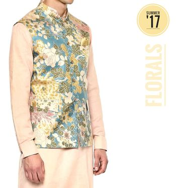 Mehendi groomwear idea with cream kurta and floral jacket