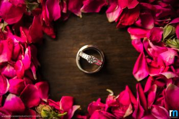 Couple Engagement Ring Surrounded By Rose Petals