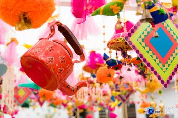 Photo of Quirky mehendi decor with hanging kettles