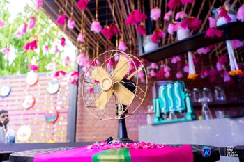 Quirky vintage theme decor with fan and florals
