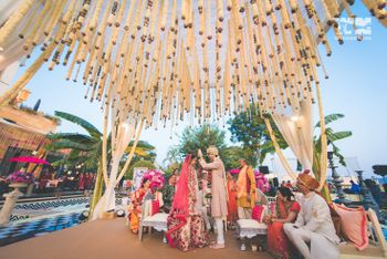 Photo of Mandap with hanging floral strings in neutral theme