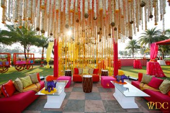Photo of Fun and playful mehendi decor with pop of colors