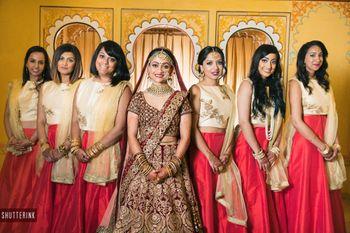 Bride with color coordinated bridesmaids