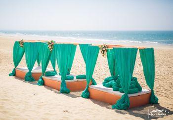 Beach wedding mandap decor with turquoise and peach