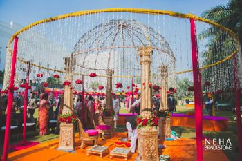 Round mandap with frame and hanging floral strings