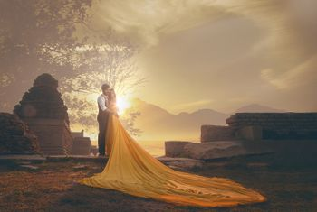 Dramatic pre wedding shoot with outfit and a train