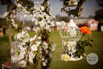 White floral birdcages in decor