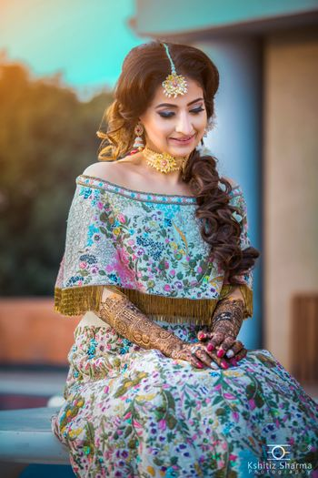 Mehendi lehenga with cape blouse and embroidery