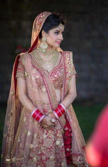 Red bridal lehenga with gold sequin work