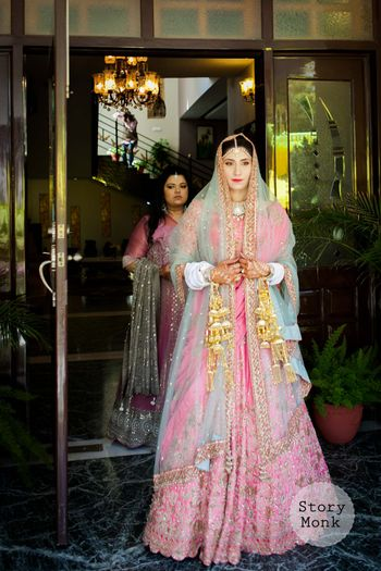 Sikh bride with light pink and blue lehenga