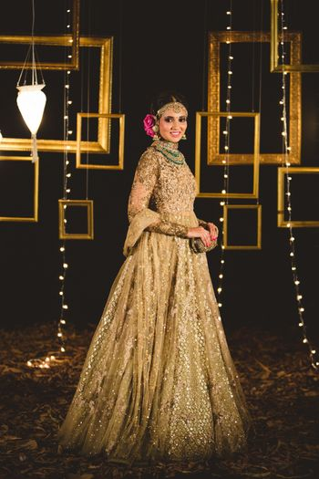 Photo of fully sequinned gold lehenga and jacket