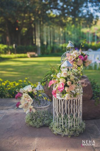 White floral birdcages in day decor