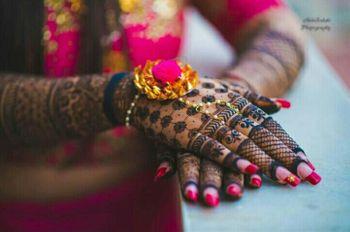 Photo of Bridal mehendi hands with lace glove mehendi and gota jewellery