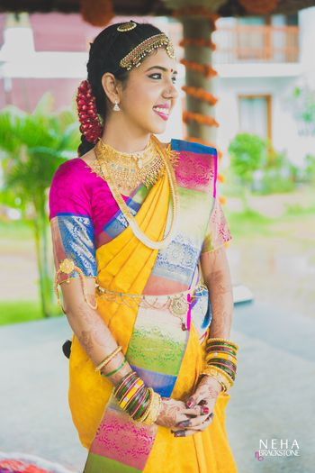 Offbeat South Indian bridal saree in yellow
