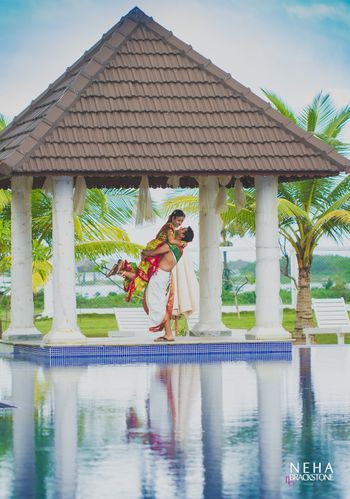 South Indian couple groom picking bride