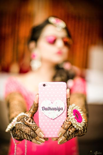 Bride holding up bridal dulhaniya phone cover