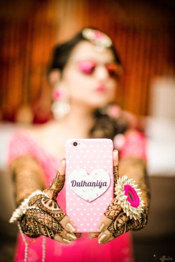 Bride holding up bridal dulhaniya phone cover