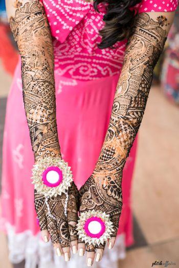 Bride showing off gota rings on mehendi hands
