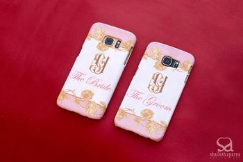 Bride and groom phone covers in white and light pink