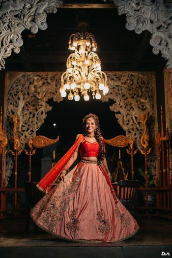 Photo of Pink and red sangeet or engagement lehenga