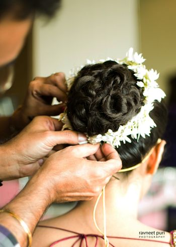 Bridal bun with braid and white flowers
