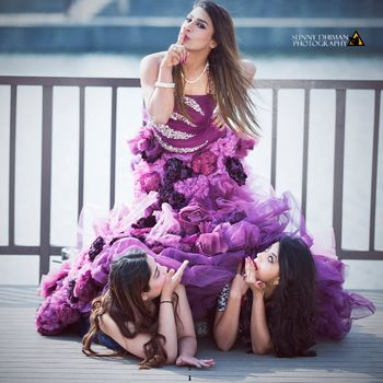 Fun filled bride with bridesmaids shot