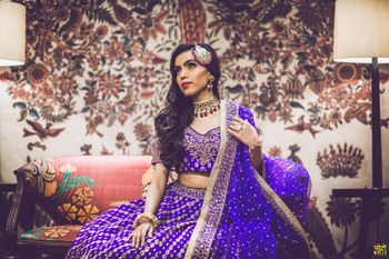 Purple and gold sangeet lehenga for bride