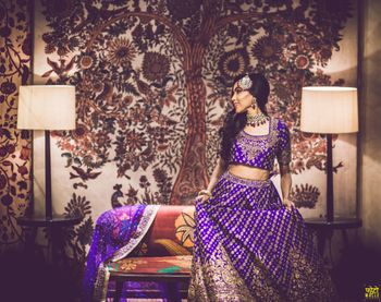 Bride in purple sangeet lehenga posing