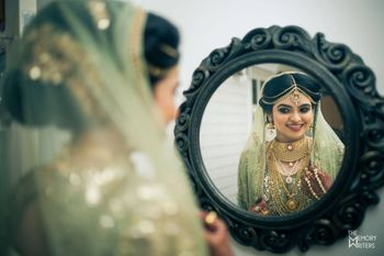 Bride looking in the mirror shot