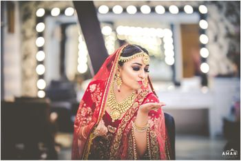 Photo of Indian bride posing on wedding day