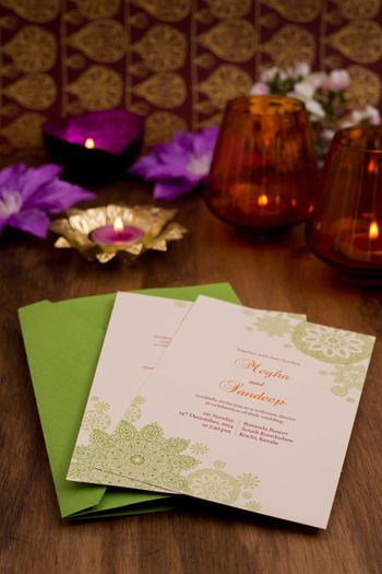 Photo of white and green wedding cards