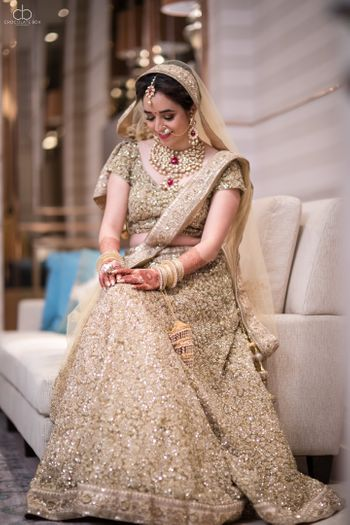 Pretty bride in gold shot on wedding day