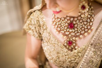 Photo of Gold and red bridal necklace with pearl drops