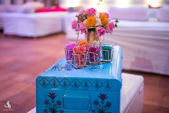 Blue trunks with floral arrangement in decor