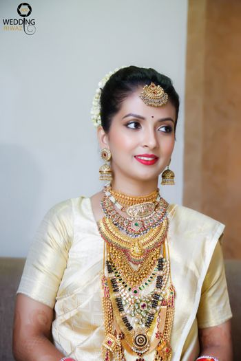 South Indian bride with multiple layered necklaces
